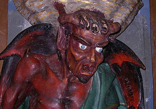 The demon Asmodeus supporting the holy water stoup at Rennes-le-Château